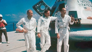 In this 1969 file photo, Apollo 11 astronauts stand next to their spacecraft in 1969, from left: Col. Edwin E. Aldrin, lunar module pilot; Neil Armstrong, flight commander; and Lt. Michael Collins, command module pilot. (AP Photo, file)