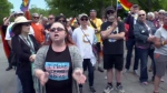A crowd of protesters wave rainbow flags and chant slogans outside St. Gregory the Great Catholic Church in Picton after an anti-Pride message was published in the church's weekly bulletin.