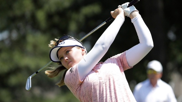Brooke Henderson watches her tee shot on the second hole during the final round of the Pure Silk Championship golf tournament at Kingsmill Resort, in Williamsburg, Va., Sunday, May 26, 2019. (AP Photo/Steve Helber)