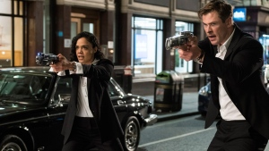 """This image released by Sony Pictures shows Tessa Thompson and Chris Hemsworth in a scene from Columbia Pictures' """"Men in Black: International."""" (Giles Keyte/Sony/Columbia Pictures via AP)"""
