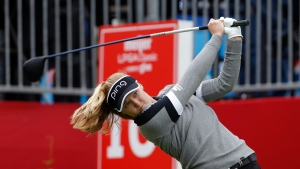 FILE - Brooke Henderson, of Canada, hits a tee shoot on the 10th hole during the final round of the Meijer LPA Classic golf tournament, Sunday, June 16, 2019, in Grand Rapids, Mich. (AP Photo/Al Goldis)