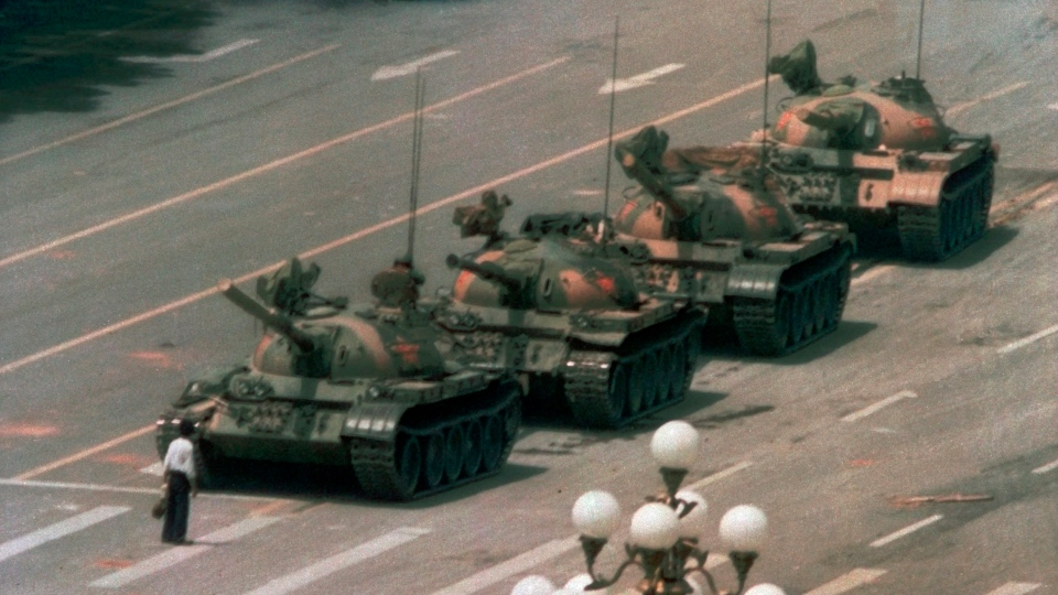 FILE - In this June 5, 1989, file photo, a Chinese man stands alone to block a line of tanks heading east on Beijing's Changan Blvd. in Tiananmen Square. (AP Photo/Jeff Widener, File)