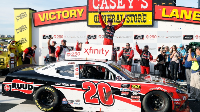 Christopher Bell celebrates in Victory Lane after winning a NASCAR Xfinity Series auto race, Sunday, June 16, 2019, at Iowa Speedway in Newton, Iowa. (AP Photo/Charlie Neibergall)