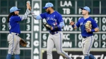 Toronto Blue Jays' Freddy Galvis, left, Lourdes Gurriel Jr., center, and Randal Grichuk celebrate the team's win over the Houston Astros in a baseball game, Sunday, June 16, 2019, in Houston. (AP Photo/Eric Christian Smith)