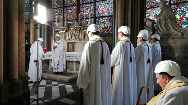 The Archbishop of Paris Michel Aupetit conducted the first mass in a side chapel two months to the day after a devastating fire engulfed Notre-Dame cathedral. (AFP)