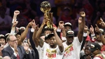 Toronto Raptors forward Kawhi Leonard, centre, holds Larry O'Brien NBA Championship Trophy after defeating the Golden State Warriors basketball action in Game 6 of the NBA Finals in Oakland, Calif. on Thursday, June 13, 2019. The Toronto Raptors are expected to return home today after their electrifying NBA championship win south of the border. THE CANADIAN PRESS/Frank Gunn