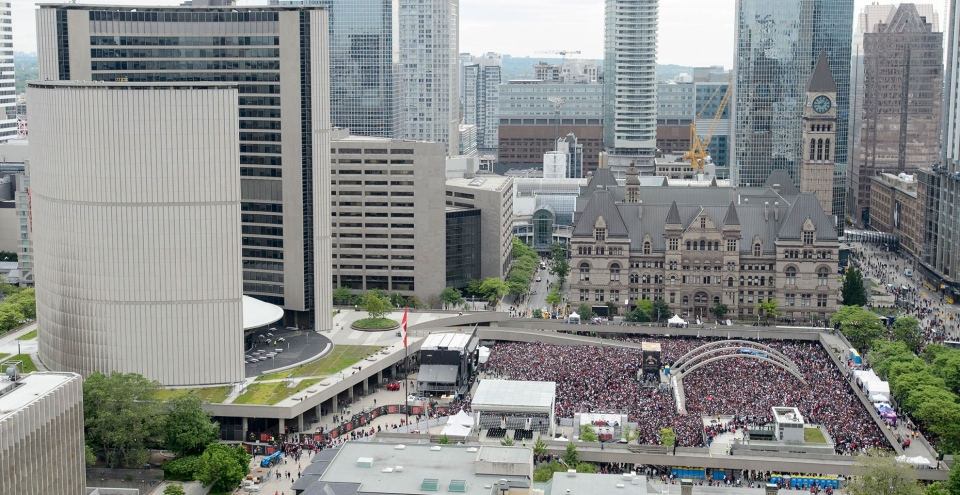 Fans pictured at Nathan Phillips Square at City Hall ahead of the 2019 Toronto Raptors Championship parade in Toronto, on Monday, June 17, 2019. THE CANADIAN PRESS/Andrew Lahodynskyj