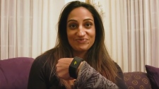 A woman wears a Pavlok wristband, which she claims helped curb a nail biting habit. (YouTube/Pavlok)