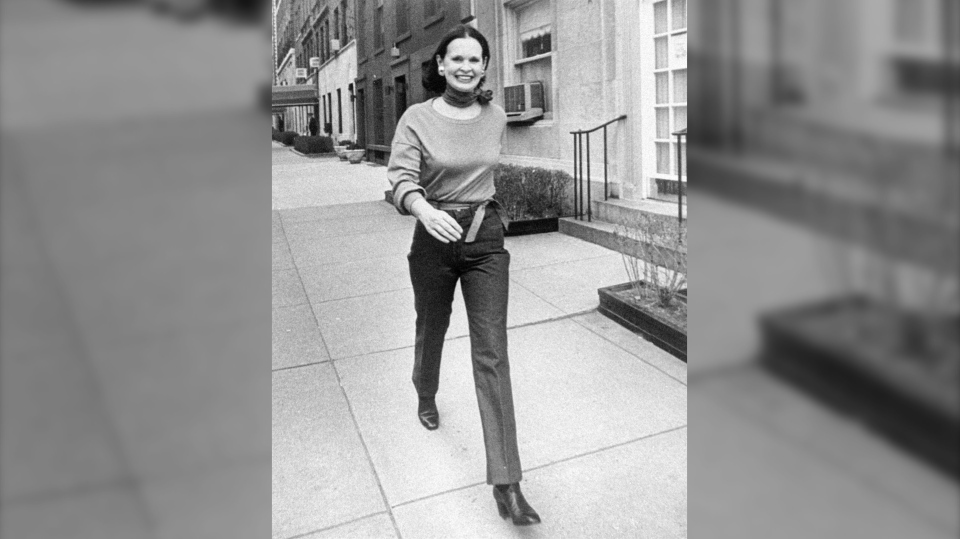 FILE- In this undated file photo heiress and designer Gloria Vanderbilt walks down a New York street. Vanderbilt died on Monday, June 17, 2019, at 95, according to her son, CNN anchor Anderson Cooper. (New York Post via AP, File)