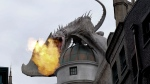 This June 19, 2014 file photo shows a dragon breathing fire from atop Gringnotts Bank during a preview of Diagon Alley at the Wizarding World of Harry Potter at Universal Orlando, in Orlando, Fla. (AP Photo/John Raoux, File)