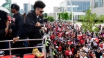 Toronto Raptors guard Danny Green smokes a cigar as he celebrates during the 2019 Toronto Raptors Championship parade in Toronto on Monday, June 17, 2019.(THE CANADIAN PRESS/Frank Gunn)