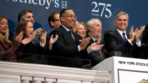 FILE - In this March 11, 2019, file photo Sotheby's Chairman Domenico De Sole, second from right, is applauded by CEO Tad Smith, right, and others as he rings the New York Stock Exchange opening bell to celebrate the company's 275th anniversary.  (AP Photo/Richard Drew, File)