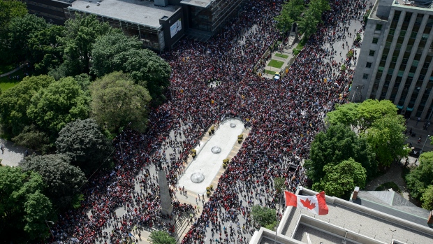 Fans fill the intersection of Queen St. West and University Avenue during the 2019 Toronto Raptors Championship parade in Toronto, on Monday, June 17, 2019. THE CANADIAN PRESS/Andrew Lahodynskyj