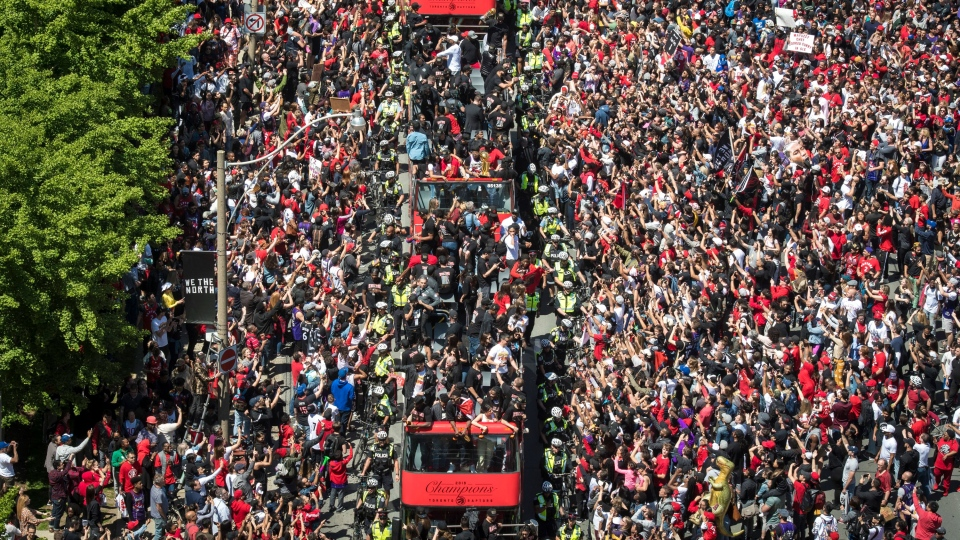 Fans flood the streets of Lake Shore Blvd. West to celebrate the Raptors during the Toronto Raptors NBA Championship Parade in Toronto on Monday, June 17, 2019. THE CANADIAN PRESS/Tijana Martin