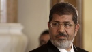 In this July 13, 2012 photo, Egyptian President Mohammed Morsi holds a news conference with Tunisian President Moncef Marzouki, at the Presidential palace in Cairo, Egypt. (AP Photo/Maya Alleruzzo, File)