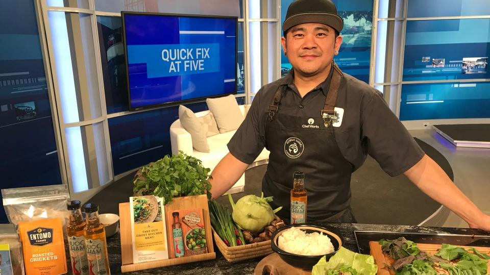 Chef Thompson Tran posing with his dish