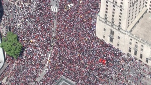 Aerial view of downtown Toronto packed with crowds