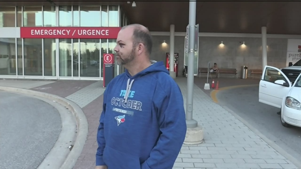 Gord Brown waits outside a Barrie hospital after allegedly being attacked by a coach in Orillia. (CTV News Barrie)