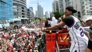 Toronto Raptors guard Kyle Lowry sprays champagne towards the fans as he celebrates during the 2019 Toronto Raptors Championship parade in Toronto on Monday, June 17, 2019. THE CANADIAN PRESS/Frank Gunn