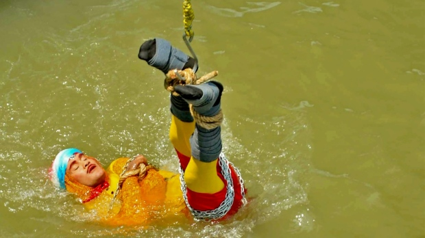 Indian stuntman Chanchal Lahiri, known by his stage name 'Jadugar Mandrake', died after being lowered into the Ganges river and failing to re-emerge. (AFP)