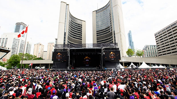 Fans gather to cheer on the Toronto Raptors during the teams championship parade in Toronto on Monday, June 17, 2019. THE CANADIAN PRESS/Nathan Denette