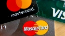FILE - In this Feb. 20, 2019, file photo photo shows a logo for Mastercard on credit cards in Zelienople, Pa. (AP Photo/Keith Srakocic, File)