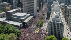 Toronto Raptors fans line University Avenue during the 2019 Toronto Raptors Championship parade in Toronto on Monday, June 17, 2019. THE CANADIAN PRESS/Andrew Lahodynskyj