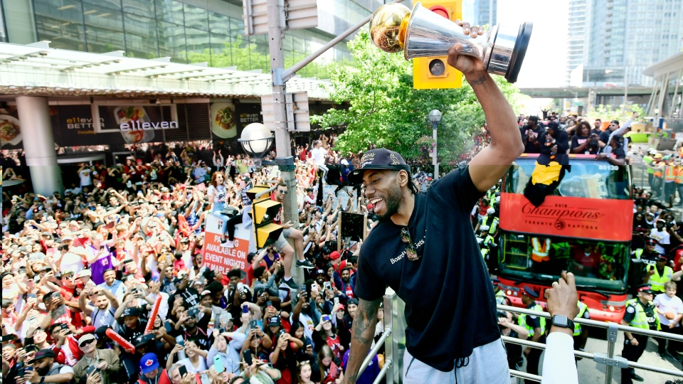 Toronto Raptors forward Kawhi Leonard hoists his playoffs MVP trophy as he celebrates during the 2019 Toronto Raptors Championship parade in Toronto on Monday, June 17, 2019. THE CANADIAN PRESS/Frank Gunn