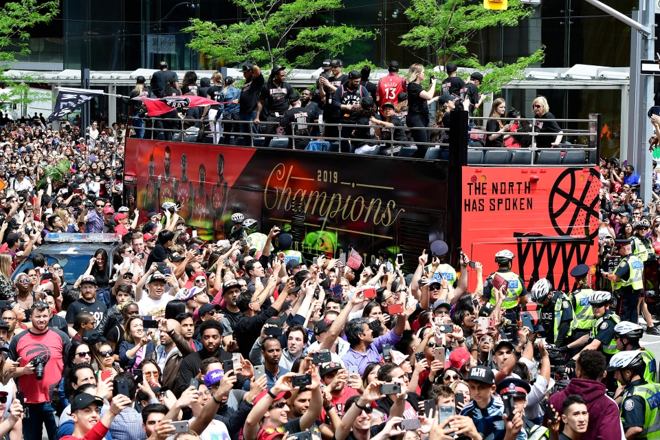 Fans celebrate during the 2019 Toronto Raptors Championship parade in Toronto on Monday, June 17, 2019. THE CANADIAN PRESS/Frank Gunn