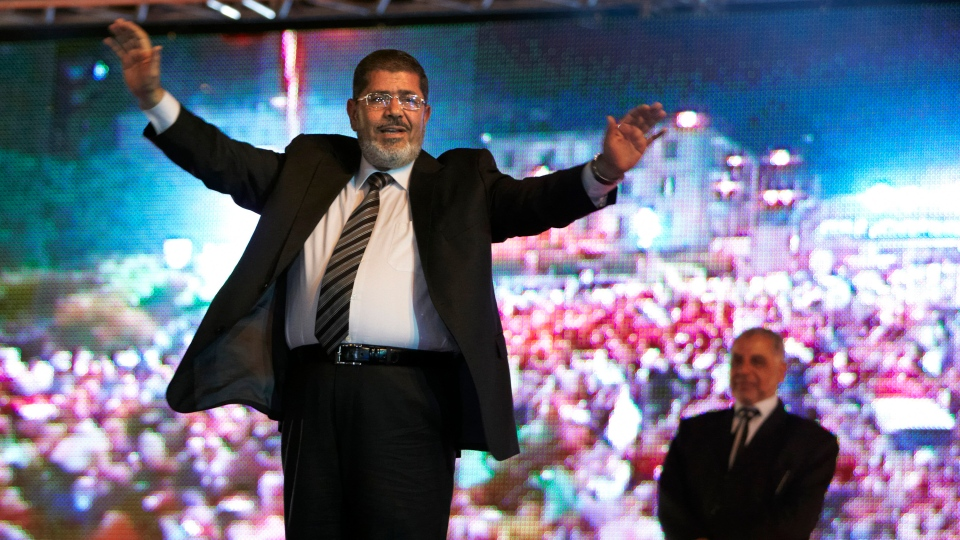 In this May 20, 2012 file photo, then Muslim Brotherhood's presidential candidate Mohammed Morsi holds a rally in Cairo, Egypt. (AP Photo/Fredrik Persson, File)