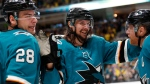 In this Feb. 16, 2019, file photo, San Jose Sharks' Erik Karlsson, center, celebrates with Timo Meier, left, and Joe Pavelski after Pavelski scored during the third period of an NHL hockey game against the Vancouver Canuck, in San Jose, Calif. The San Jose Sharks re-signed pending free agent Erik Karlsson to an eight-year deal on Monday, June 17, 2019, turning a one-year rental into a long-term commitment to one of the league's most dynamic defensemen.(AP Photo/Josie Lepe, File)