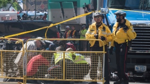 First responders attended to an injured person after reports of shots fired during the Toronto Raptors NBA Championship victory celebration near Nathan Phillips Square in Toronto on Monday, June 17, 2019. THE CANADIAN PRESS/ Tijana Martin