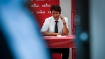 Prime Minister Justin Trudeau makes phone calls to gather support for local candidates in a byelection campaign office in Calgary, Alta., Wednesday, March 1, 2017.THE CANADIAN PRESS/Jeff McIntosh