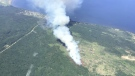 Aerial image shows retardant lines around the wildfire.