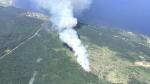 Aerial image shows retardant lines around the wildfire.