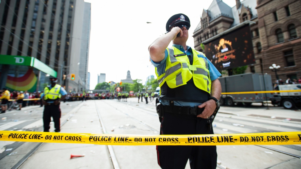 Toronto Police secure the scene after a shots were fired during the 2019 Toronto Raptors Championship parade in Toronto, on Monday, June 17, 2019. THE CANADIAN PRESS/Andrew Lahodynskyj