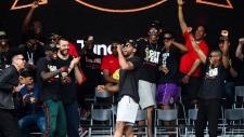 Toronto Raptors forward Kawhi Leonard speaks to fans during the 2019 Toronto Raptors Championship parade in Toronto, on Monday, June 17, 2019.(THE CANADIAN PRESS/Nathan Denette)
