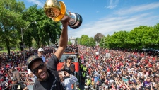 Toronto Raptors' Kawhi Leonard holds his MVP trophy while celebrating with Drake during the 2019 Toronto Raptors Championship parade in Toronto, on Monday, June 17, 2019. THE CANADIAN PRESS/Frank Gunn