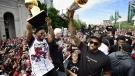 Toronto Raptors' Kawhi Leonard holds his MVP trophy while celebrating with Drake during the 2019 Toronto Raptors Championship parade in Toronto, on Monday, June 17, 2019. THE CANADIAN PRESS/Frank Gunn