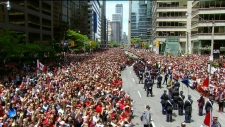 Thousands of fans cheers at Toronto City Hall during the 2019 Toronto Raptors Championship parade in Toronto, on Monday, June 17, 2019. THE CANADIAN PRESS/Nathan Denette