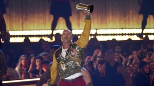 Dwayne Johnson, also known as The Rock, accepts the generation award at the MTV Movie and TV Awards on Saturday, June 15, 2019, at the Barker Hangar in Santa Monica, Calif. (Photo by Chris Pizzello/Invision/AP)