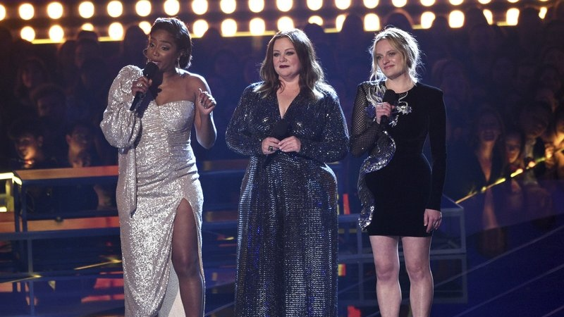 Tiffany Haddish, from left, Melissa McCarthy and Elisabeth Moss introduce a performance by Lizzo at the MTV Movie and TV Awards on Saturday, June 15, 2019, at the Barker Hangar in Santa Monica, Calif. (Photo by Chris Pizzello/Invision/AP)