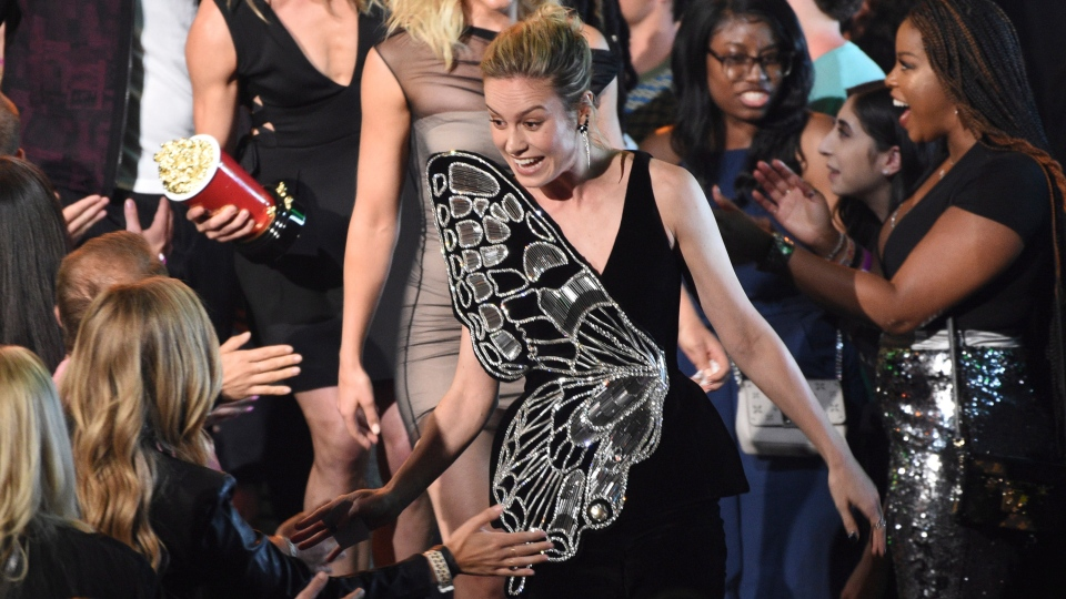 """Brie Larsen, winner of the award for best fight for Captain Marvel vs. Minn-Erva in """"Captain Marvel,"""" walk in the audience at the MTV Movie and TV Awards on Saturday, June 15, 2019, at the Barker Hangar in Santa Monica, Calif. (Photo by Chris Pizzello/Invision/AP)"""
