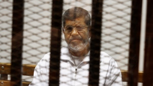 FILE - In this May 8, 2014 file photo, Egypt's ousted Islamist President Mohammed Morsi sits in a defendant cage in the Police Academy courthouse in Cairo, Egypt. (AP Photo/Tarek el-Gabbas, File)