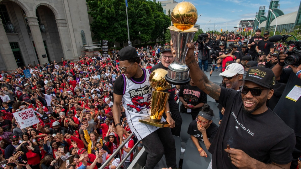 Toronto Raptors' Kawhi Leonard and Kyle Lowry hold up the trophies as they celebrate during the 2019 Toronto Raptors Championship parade in Toronto, on Monday, June 17, 2019. THE CANADIAN PRESS/Frank Gunn