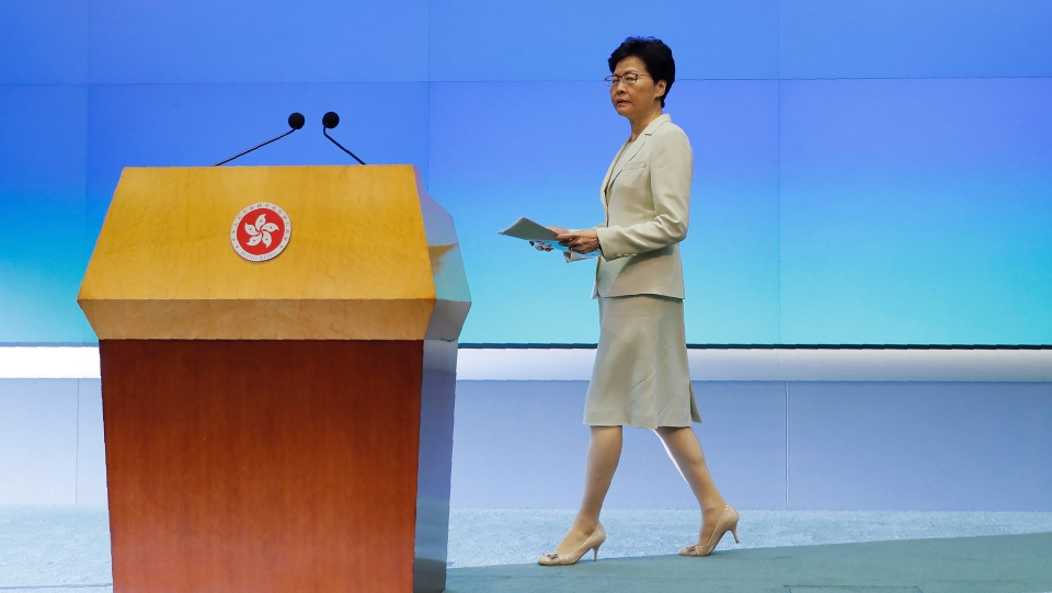 Hong Kong Chief Executive Carrie Lam arrives to give a press conference at the Legislative Council in Hong Kong, Tuesday, June 18, 2019. Hong Kong leader apologizes for her handling of unpopular extradition bill, says the city needs hope. (AP Photo/Kin Cheung)