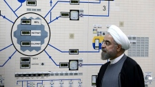 FILE - In this Jan. 13, 2015 file photo, released by the Iranian President's Office, President Hassan Rouhani visits the Bushehr nuclear power plant just outside of Bushehr, Iran. (AP Photo/Iranian Presidency Office, Mohammad Berno, File)