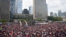 Crowds gather in Nathan Phillips Square as they prepare to celebrate the Toronto Raptors winning the NBA Championship in Toronto on Monday, June 17, 2019. THE CANADIAN PRESS/Chris Young