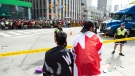 Toronto Raptors fans look on at a scene where shots were fired during the 2019 Toronto Raptors Championship parade in Toronto, on Monday, June 17, 2019. THE CANADIAN PRESS/Andrew Lahodynskyj