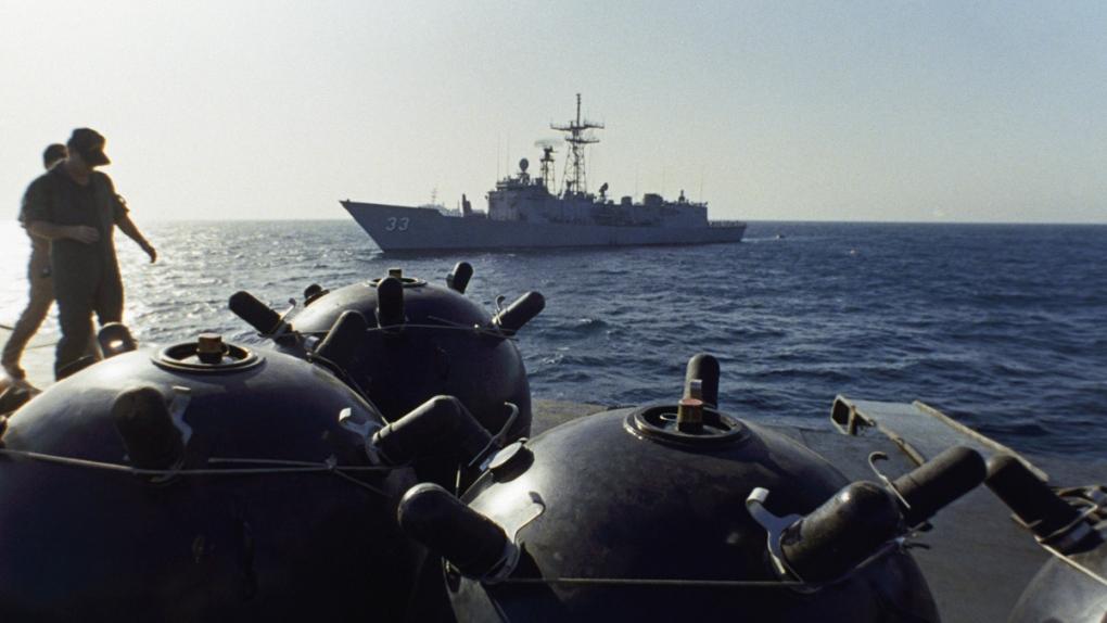 U.S. personnel inspecting Iranian vessel in 1987